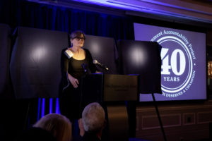 Image: Kristina Borjesson speaking at podium during GAP celebration