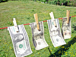 Image: US currency on a clothesline