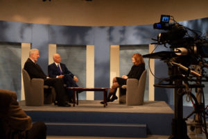 Image of Dennis McCuistion, Jim Faulk and Marianne Jennings on the McCuistion TV set.