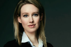 Photo of Elizabeth Holmes wearing a blazer and collared shirt.