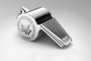 Photo of a silver whistle with the SEC's logo on the side.