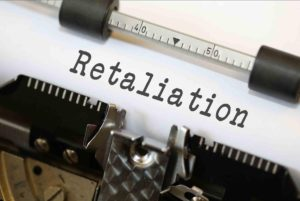 "Image: Typwriter with ""Retaliation"" typed on page"