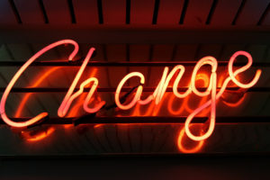 "Image of orange neon sign that says ""Change"""