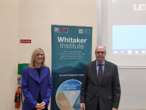 Photo of Kate Kenny and Richard M. Bowen by a sign for the Whitaker Institute.